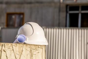 Blueprints and white helmet.