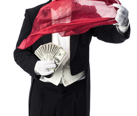 Magician doing an appearance and vanish trick with money