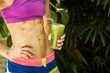 Athletic girl holding a green smoothie - 81662394