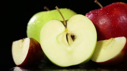 Fresh apples on black background