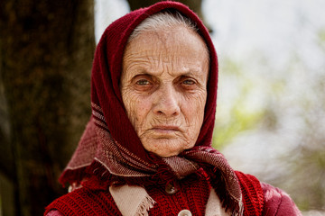 Old rural woman with kerchief outdoor