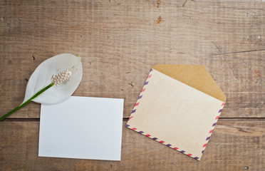 Old envelope and card with flower