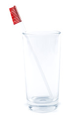 Toothbrush in a glass on a white background.