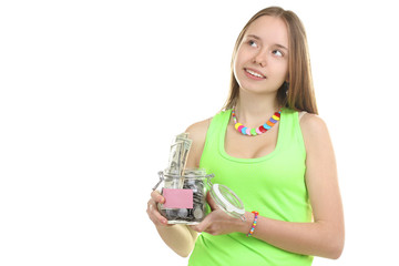 An attractive young woman holds up a bag of money while