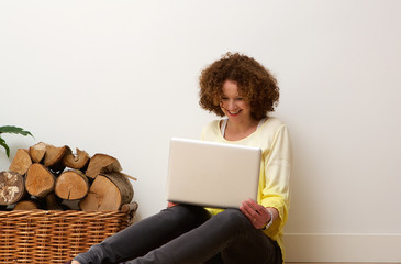 Happy older woman using laptop oat home