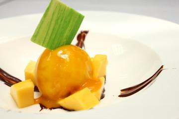 homemade mango ice cream with fresh mangos.
