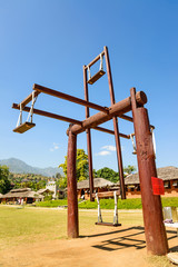 Hill tribes wooden swing at countryside of Thailand at Santichon