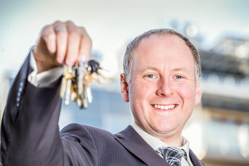 Man encouraging to choose key to brand new apartments