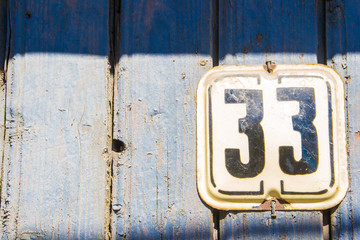 Number 33 on the wooden blue crack wall