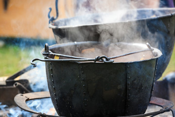 Soup cooking in medieval pot