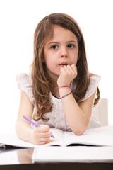 Thinking girl in kindergarten