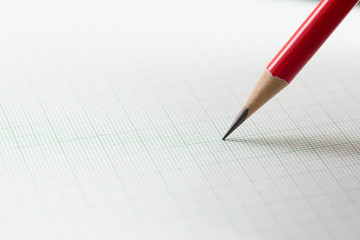 graph paper with red pencil