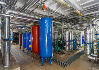 industrial boiler interior with lots of pipes, pumps and valves