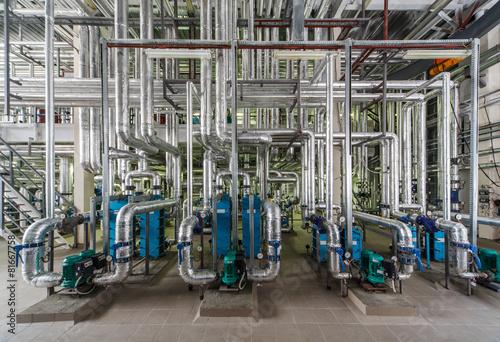 Zdjęcia na płótnie, fototapety, obrazy : industrial boiler interior with lots of pipes, pumps and valves