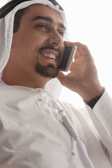 Arabian Male Using Smart Phone Indoors