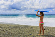 Summer on the beach, portrait of young surfer girl