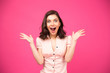 Surprised woman shouting over pink background - 81669975