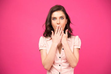 Surprised woman covering her mouth with hands
