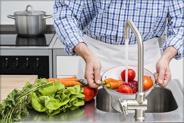 Washing vegetables in kitchen