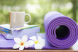 yoga mat and a cup of coffee - 81674395