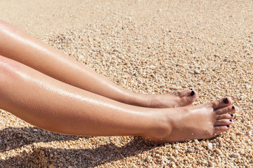 Two feet of girl at beach