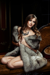 Young pretty naked woman in fur