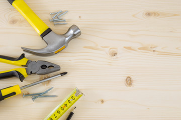 Set of carpenter tools and supplies on wooden surface including