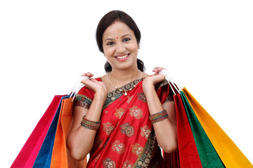 Happy traditional Indian woman with shopping bags