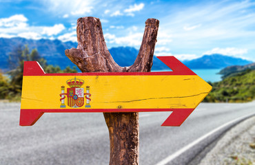 Spain Flag wooden sign with road background