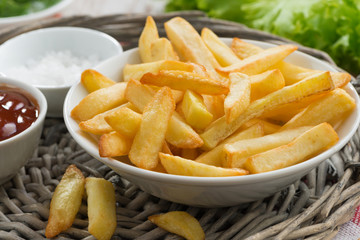 fried french fries with tomato sauce, close-up