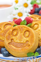 smiling tasty corn pancake with berries