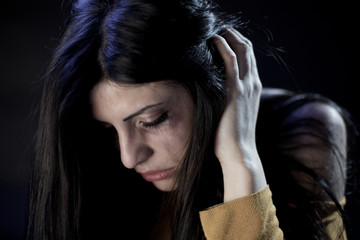 Beautiful woman crying holding head scared