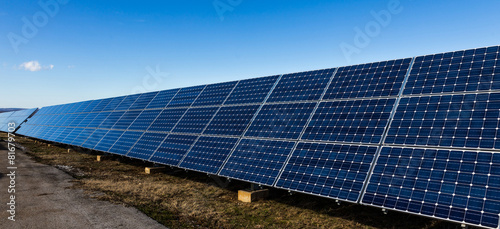Lots of solar panels in a row - 81679703