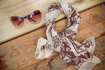 Women's fashion accessories. Sunglasses and a floral scarf