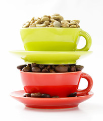 green and black coffee beans in cup on a white background