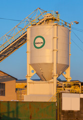Industrial silo for the production, blue sky