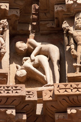 Stone carved erotic sculptures on temple. Khajuraho
