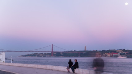 Bridge 25 de Abril on river Tagus at sunset, Lisbon, Portugal