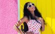 Leinwanddruck Bild - Attractive smiling african american woman wearing sunglasses