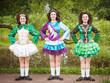 Three young beautiful girls in irish dance dress and wig posing