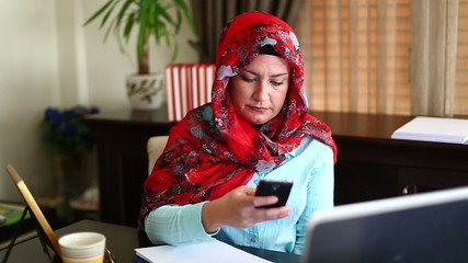 Muslim Business Woman Working and Talking Phone in Office