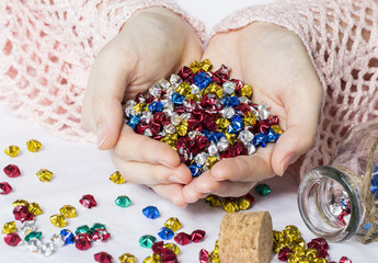 Woman hands holding origami stars