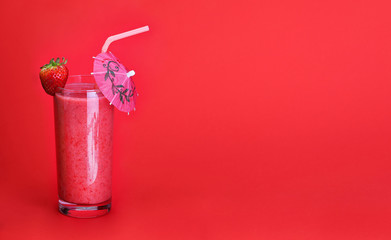 healthy glass of smoothies strawberry flavor on red background