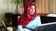 Muslim Business Woman Working with Laptop and Taking Note