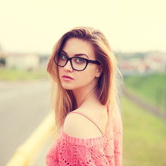 stylish hipster girl in sunglasses on a sunny day