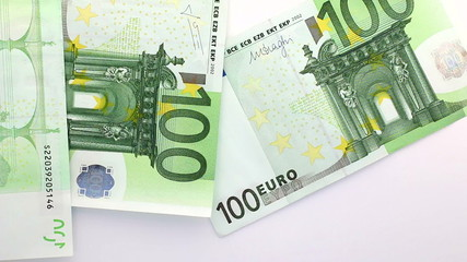 Euro banknotes falling down on white