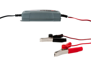 Modern electronic charger for car battery with clamps