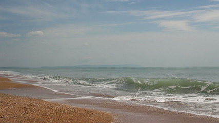 light breeze at the seaside with waves