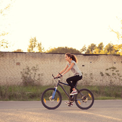 beautiful girl on the bike goes in for sports