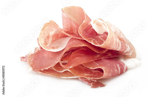 Italian prosciutto crudo ,raw ham leg sliced on white - 81685972